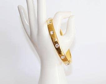 Vintage Monet gold tone bangle. Monet gold tone and rhinestone bangle. Round bangle