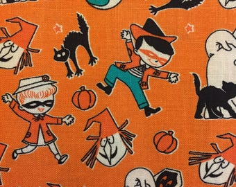Trick or Treat Toss Halloween fabric in Orange by Penny Rose Fabrics