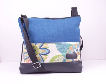 Cross body bag. Teal blue fabric, Black vinyl base and back. PVC covered Blue, green and orange floral fabric
