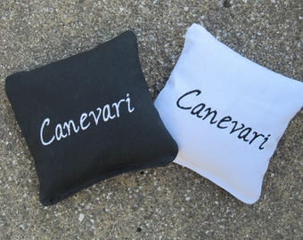 Custom Cornhole Game Bags with a Last Name - Set of 8 Shown in Black and White