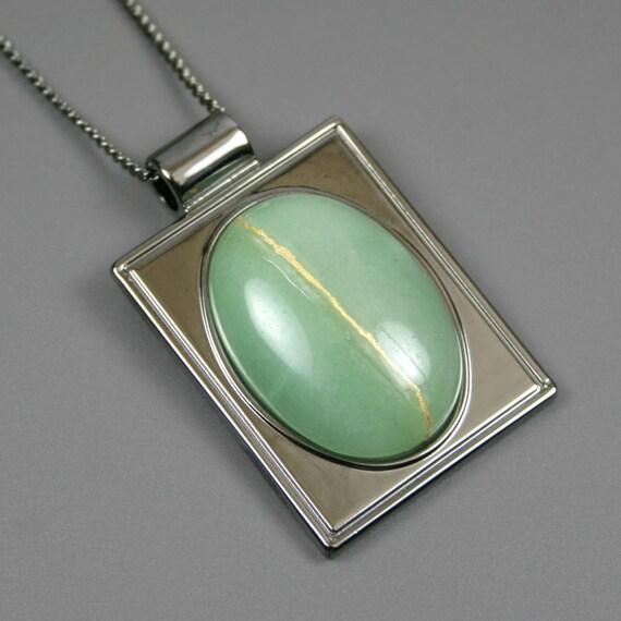 Kintsugi (kintsukuroi) green aventurine stone cabochon with gold repair in a rectangular gunmetal plated setting on gunmetal chain - OOAK