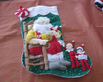 "Bucilla completed 18"" felt stocking ""Santa and his elves"""