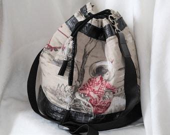leather and canvas handbag