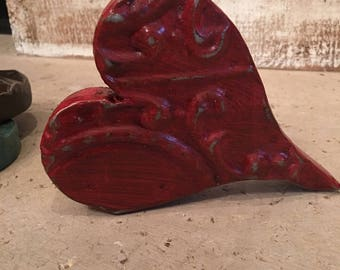 Ornate distressed red heart designed with antique tin ceiling tile