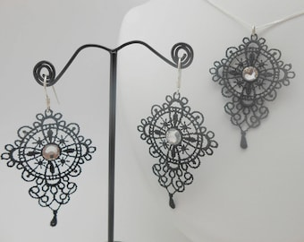 Set in 925 sterling silver and Black Lace