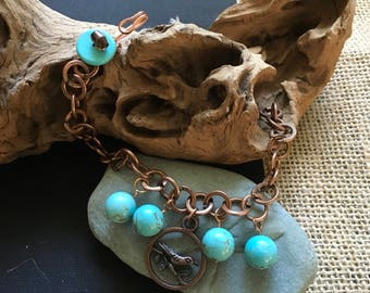 Copper bird and turquoise bracelet