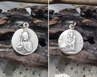 Old sterling charm. Sacred heart and Our Lady of Carmel.