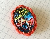 Attack of the Crab Monsters brooch embellished with yarn