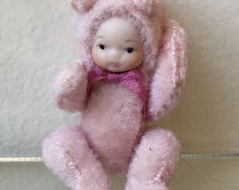 """Dollhouse Miniature 1"""" Scale Porcelain Baby in a Pink Teddy Bear Suit (JL)"""