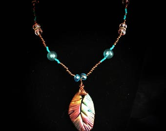 Faux Rainbow Raku Feather n copper and turquoise beads, crystals, sea glass and toggle clasp
