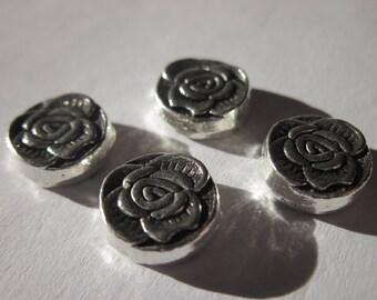 4 reversible 1 cm silver metal flower shaped beads (1955)
