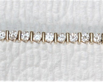 Gold on Sterling silver tennis bracelet with CZ's