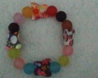 Butterfly and acrylic bead stretch bracelet