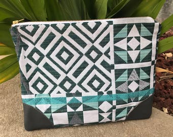 Teal clutch with leather corners