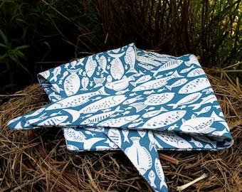 A dog bandana.  Size small to medium.  Fish design.  54cm x 19cm.