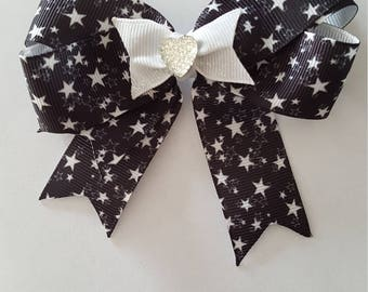 Star design hair Bow, with sparkle ribbon and a diamante centre detail
