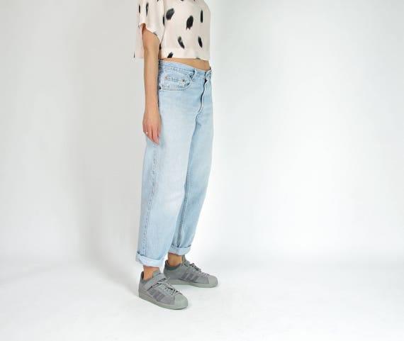 SALE! 90s Levi's 560 light wash denim tapered legs jeans / size w32 l30