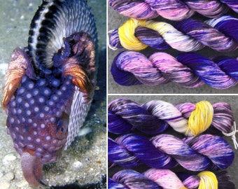 Argonaut 20g mini skein, purple black speckled cephalopod theme merino nylon sock yarn