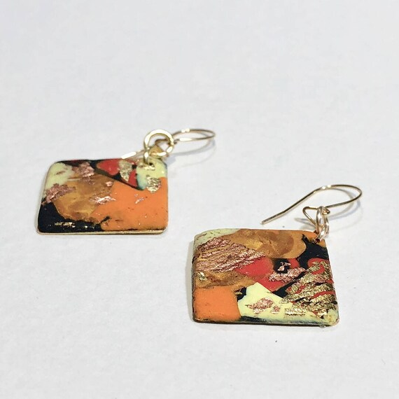 Earrings - contemporary orange red black yellow handmade polymer clay on diamond shaped gold plated piece with 14K gold filled ear wire
