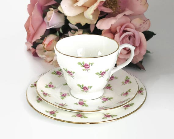 Duchess trio, cup, saucer, and plate with pattern of scattered pink roses, gilt trim, fine bone china, England, circa 1960s