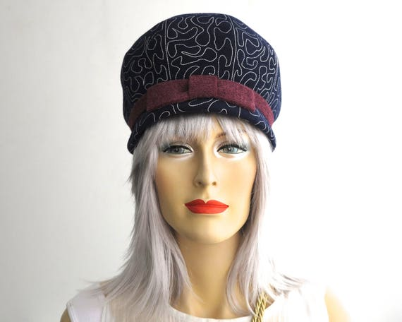 Vintage navy blue dome hat, wool felt with all over white stitching, narrow brim, burgundy colored band and bow, Leonora brand, small, 1960s