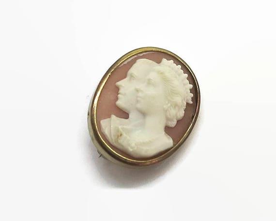 Souvenir cameo brooch of coronation of Queen Elizabeth II, profiles of the queen and Prince Phillip, c clasp, souvenir, mid 20th century
