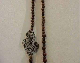 long necklace with wooden beads and leather