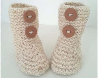 Slippers for baby birth in 12 beige woolen months with brown buttons