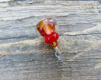 Lampwork glass pendant with sterling silver bail.