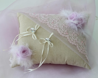 Pillow-bearer in linen with lace pearls flowers and feathers