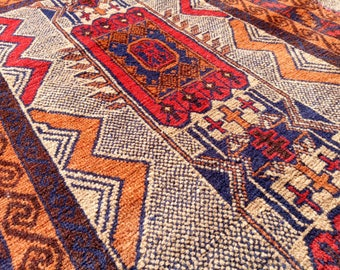 Hand-knotted geometric tribal Persian rug in rich autumn tones