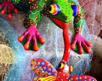 Spectacular large alebrije of frog catching a butterfly, Mexico