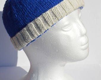 Handknitted blue and white adult size beanie
