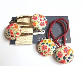 Liberty of London floral fabric covered button hair ties and snap clip set.