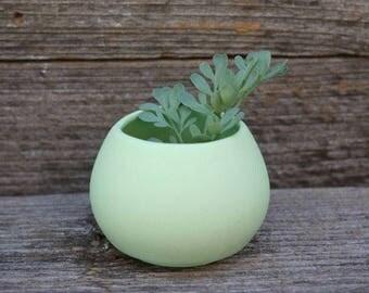 Small vase of green matt porcelain