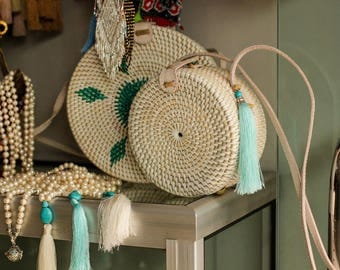 The white Ata grass bag , a must have for every girl this summer
