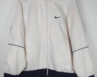 Vintage Nike Swoosh white small logo windbreaker jacket