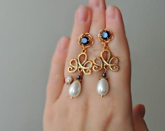 Classic Earrings with Zircons and Pearl Suspension