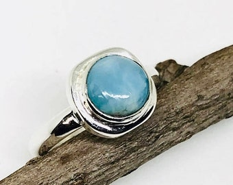 10% Larimar ring set in sterling silver (92.5). Size- 6, 7. Natural authentic larimar stone .