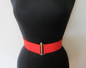 """Ladies Vintage Red Elastic Belt- lovely accessory from the '80s. Gold plated metal art Deco interlocking fastening closure. For a 24"""" waist!"""