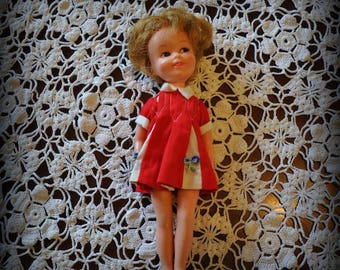 Deluxe Reading Corp. Vintage Doll, 8 in. tall.