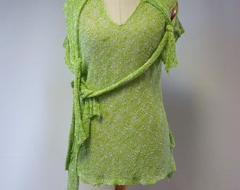 The hot price. Transparent delicate light green boucle top, M size. Perfect for Summer.