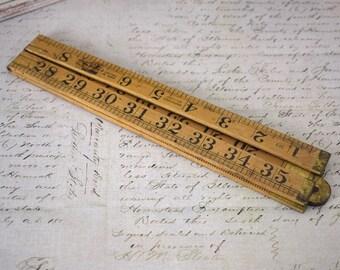 Vintage wooden folding ruler or measuring stick, yardstick
