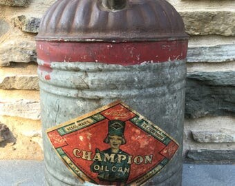 Vintage Nescoware Champion Oil Can...Galvanized. Metal. Paper. Graphic. Advertising. Automobile. Cars. Red. Silver. Blue. Boy. Ephemera.