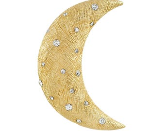 Christian Dior crescent moon brooch in gold plate and crystal.