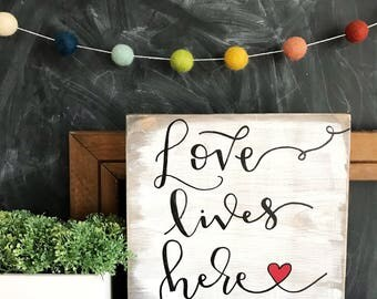 Love Lives Here hand lettered sign - farmhouse sign - entryway sign- valentine's day sign - living room sign sign - dining room sign