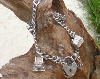 Vintage Sterling Silver Charm Bracelet With Four Charms