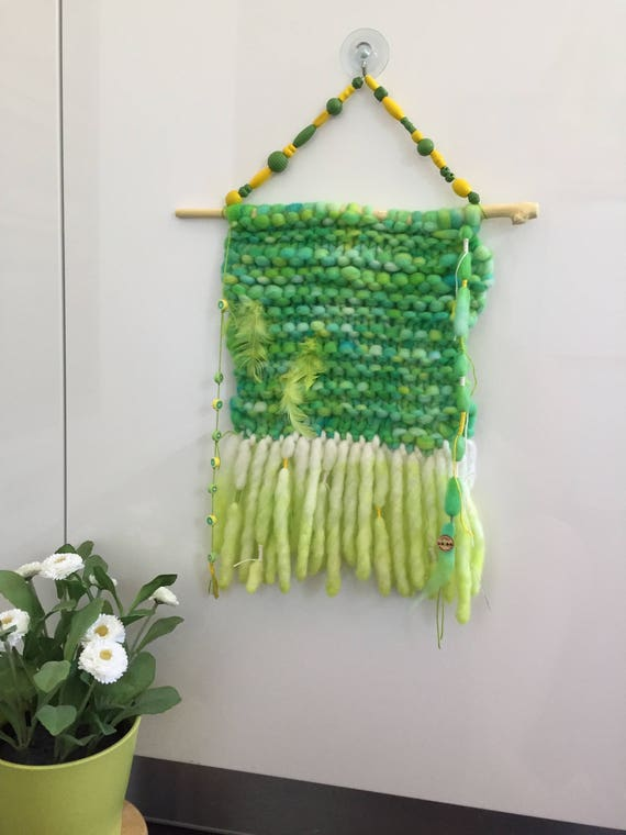 Chuncky knit, hand dyed Merino wool wall hanging in lemon and lime. With beads and feathers.