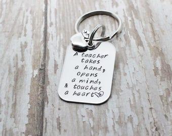 Hand stamped Teacher keychain / a teacher takes a hand opens a mind a touches a heart