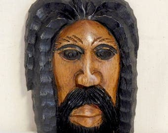 Soulful woodcarving of man's face--Black Jesus?